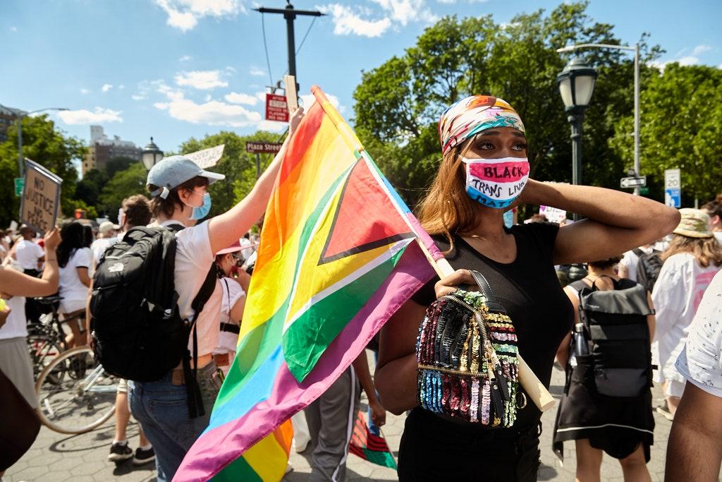 Woman at rally wearing mask reading